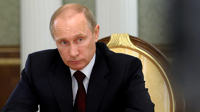 Russia's President Vladimir Putin attends a session of the Supreme Eurasian Economic Council in Minsk, on April 29, 2014.