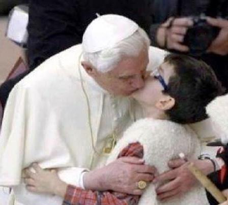 Former Pope Joseph Ratzinger kissing a young parishioner