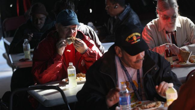 Homeless US military veterans eat a free lunch at a Stand Down event hosted by the Department of Veterans Affairs