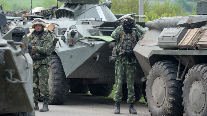 Ukrainian troops outside the town of Andreyevskoe near Slaviyansk, Donetsk Region, where local residents blocked a column of Ukrainian Army armored personnel carriers