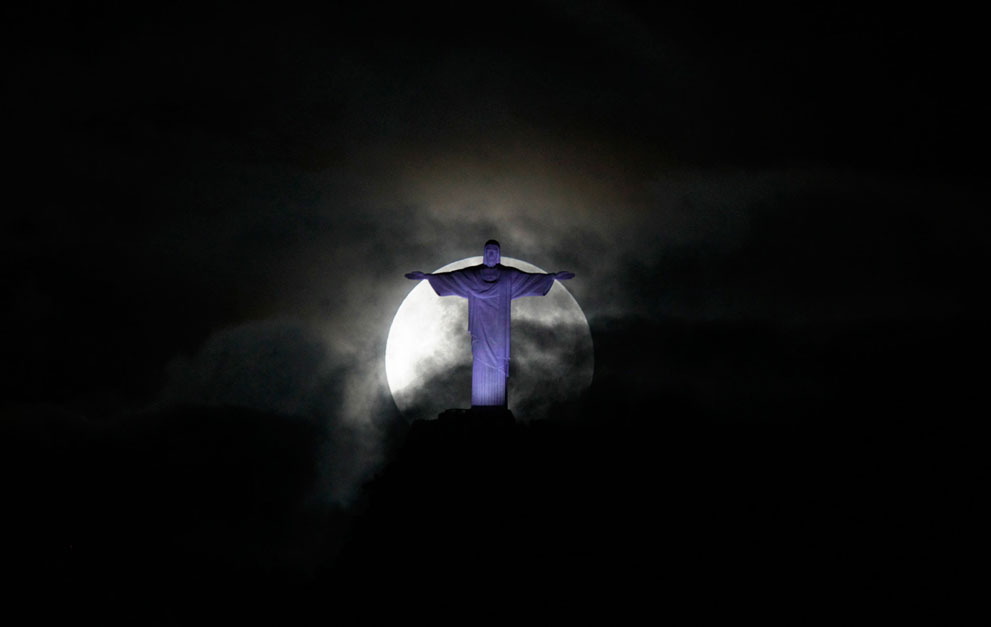 The full supermoon, behind the massive statue of Christ the Redeemer above Rio de Janeiro, Brazil, on May 6, 2012