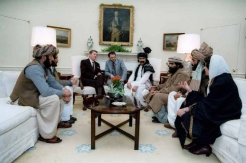 President Ronald Reagan sitting in the White House with Afghan freedom fighters in February 1983