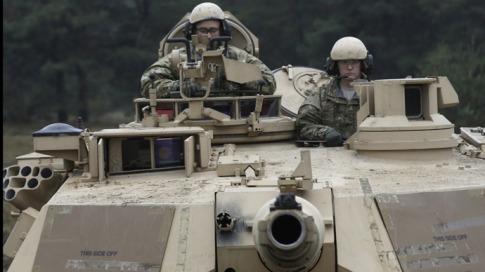 U.S. soldiers deployed in Latvia sit in an Abrams tank during a drill at Adazi military base October 14, 2014