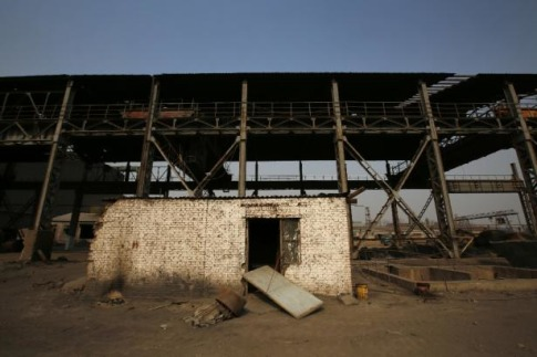 A damaged house is pictured inside an abandoned steel mill of Qingquan Steel Group in Qianying township, Hebei province February 18, 2014. Picture taken