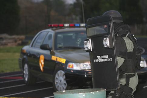 Vaccine-Enforcement-Shield-Car