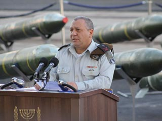 IDF chief Gadi Eizenkot with some of munitions he intends to hurl against 1.5-million Lebanese civilians