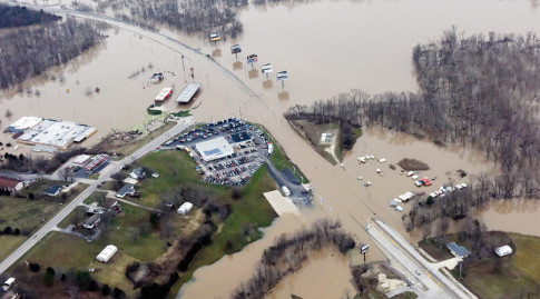 Submerged roads and houses are seen after several days of heavy rain led to flooding, in an aerial view over Union, Missouri December 29, 2015