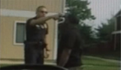 US cop places gun in black mans mouth to show off to his friends