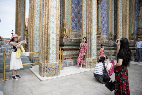 Chinese tourists at the Grand Palace in Bangkok. The wealthy parts of the city are still jammed with Thais and tourists