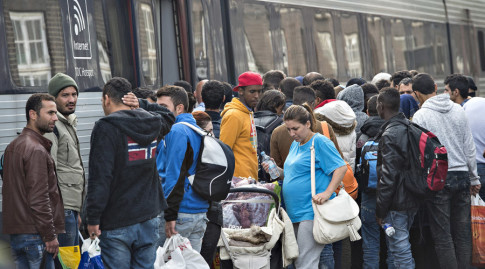Migrants, mainly from Syria, prepare to board a train headed for Sweden, at Padborg station in southern Denmark