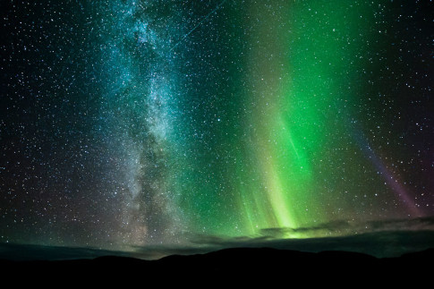 northern lights, the Milky Way and several shooting stars are seen in the night sky at Ifjord in Finnmark, Norway