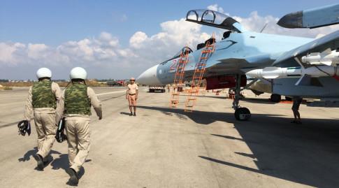 The crew of a Russian Su-30 fighter prepare to take off at Hmeimim aerodrome in Syria