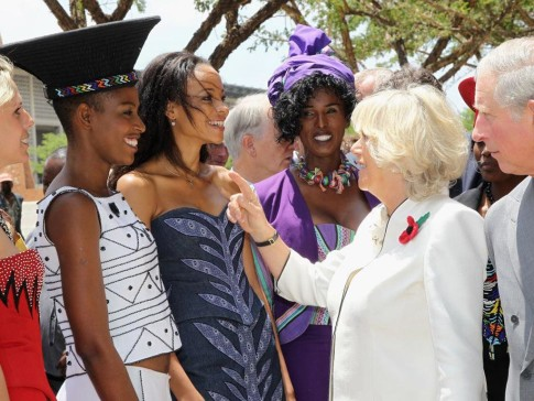 Prince Charles and Camilla meet models in Zulu attire in Soweto, South Africa