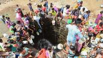 Villagers collect water after a tanker delivery in Shahapur