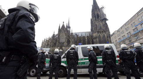 German riot police stand in front of the Cologne Cathedral in Cologne
