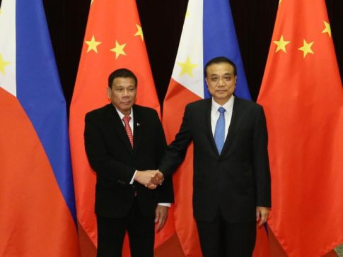 philippine-president-rodrigo-duterte-left-shakes-hands-with-chinese-premier-li-keqiang
